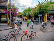 Locals and tourists walking along the street during the late afternoon in Hoi An Ancient Town, Quang Nam Province, Vietnam