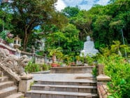 Sitting Buddha Statue and Landscaped Stairways at Linh Ung Pagoda, Marble Mountains in Da Nang, Vietnam
