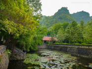Dinh Thien Hoang Temple surrounded by limestone mountains, in Ninh Binh, Vietnam, on September 2015